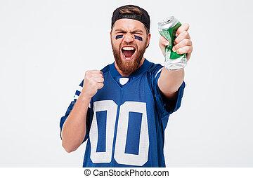 Excited man fan holding beer bottle.