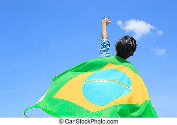 Excited man holding brazil flag