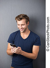 Excited man reading an sms on his mobile