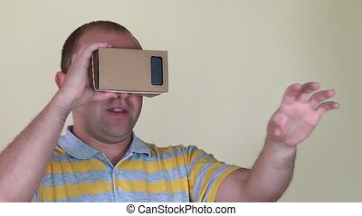 Excited man using VR virtual reality glasses. closeup