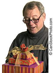man with christmas hanukah gifts