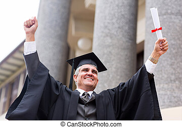 excited middle aged university graduate with arms...