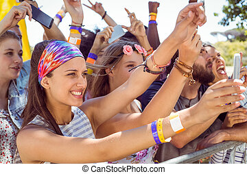 Excited music fans up the front at a music festival