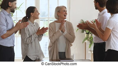 Excited older best employee get appreciated by business team...