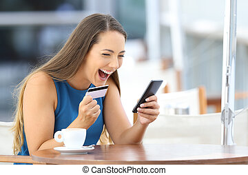 Excited on line buyer paying with credit card