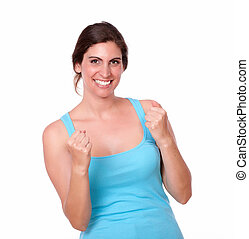 Excited pretty woman gesturing winning celebration
