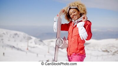 Excited skier waving from top of slope - Excited young...