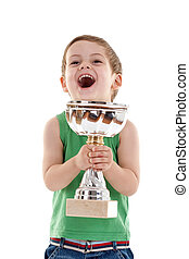 excited small boy with trophy