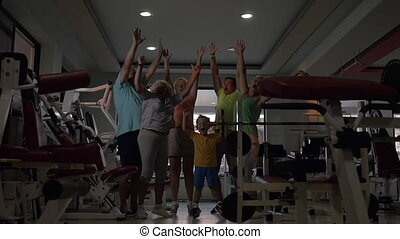 Excited sportive family in the gym - Slow motion of happy...