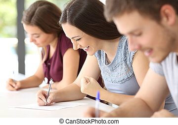 Excited student during an exam at classroom