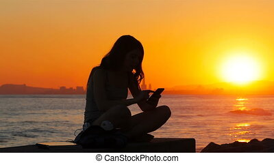Excited student reading good online news at sunset -...