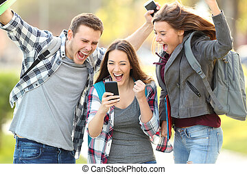 Excited students checking exam grades online