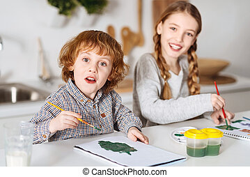 Excited talented siblings drawing some greens