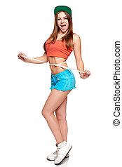Excited teen girl in full length standing measuring her waist