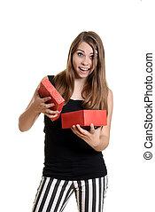 teen girl with christmas present