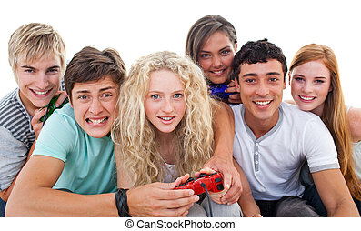 Excited teenagers playing video games in the living-room -...