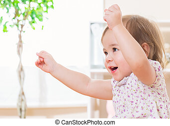 Excited toddler girl with a big smile