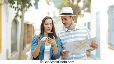 Excited tourists finding best online offer on vacation -...