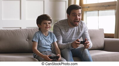 Excited two generations family playing online video game.