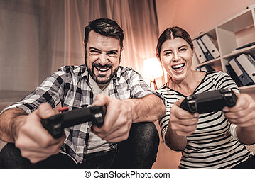 Excited woman and man playing a video game