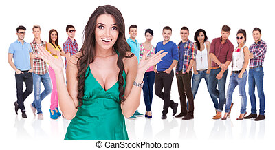 excited woman in front of a group of casual people