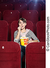 Excited woman in the movie theater