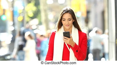 Excited woman receiving good news online - Front view of an...