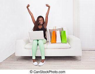 Excited Woman Shopping Online At Home