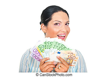 Excited woman showing money