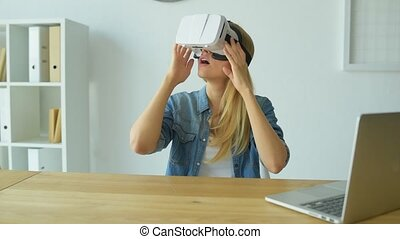 Excited woman trying on visual reality headset - This is so...