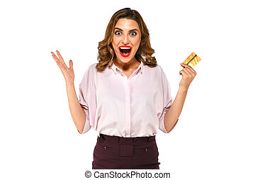 Excited woman with gold credit card in hand on white isolated background
