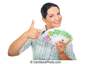 Excited woman with money giving thumbs up