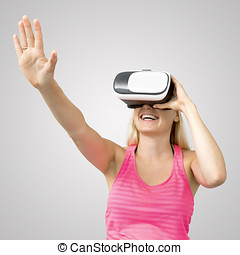 excited woman with virtual reality glasses isolated on gray