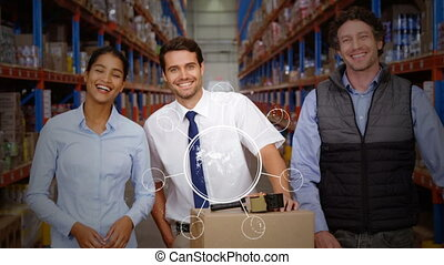 Excited workers in a warehouse holding box
