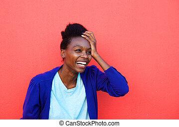Excited young african woman laughing