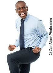Excited aged businessman clenching fists