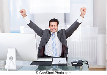 Businessman Raising His Hands In Joy
