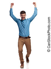 excited young casual man celebrating success