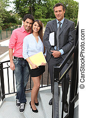 Excited young couple buying first house