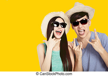 excited young couple having fun in summer dress