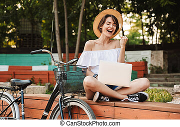Excited young girl dressed in summer clothes