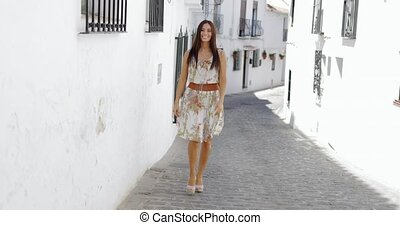 Excited young girl walking in sunny street