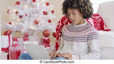 Excited young woman making a surprise find on the internet...