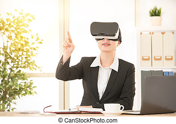 excited young woman using a VR headset