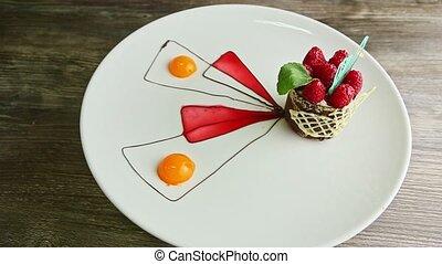 exclusive decorated raspberry dessert spin around on white ...