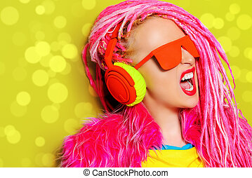 exclusive - Modern party girl DJ in bright clothes,...