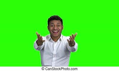 Excted Indian businessman celebrating succes.