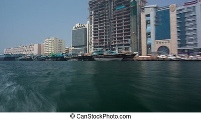 Excursion on traditional Abra boat at the creek in Dubai, UAE timelapse