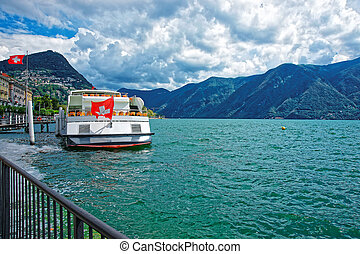 Excursion ship at promenade in Lugano in Ticino Switzerland...