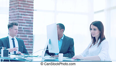 Executive business woman in office on the background of business team